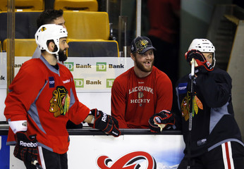 The Chicago Blackhawks Bickell talks to teammates Bollig and Brookbank during optional team practice in Boston