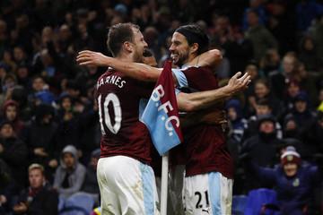 Burnley's George Boyd celebrates scoring their third goal with Ashley Barnes