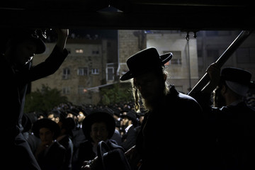 Ultra-Orthodox Jewish men attend a demonstration against plans to enlist men from their community into the military in Jerusalem