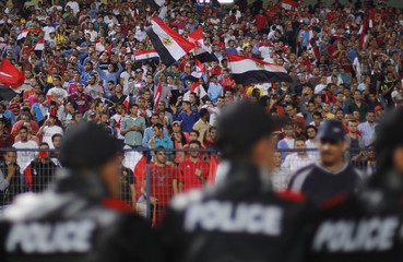 Fans of the Egypt team cheer during their African Nations Cup qualifying soccer match against Botswana in Cairo