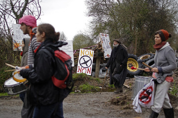 People take part in a demonstration against plans to construct a new airport in Notre-Dame-des-Landes