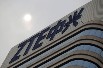 ZTE's logo on its R&D center is seen electronic wires in Beijing