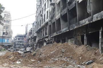 Damaged buildings and rubble are seen in old Homs city