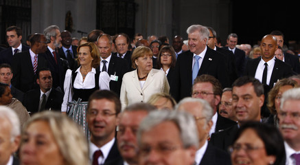 German Chancellor Merkel, Bavarian PM and leader of CSU Seehofer arrive for oecumenic service at St. Michaels church in Munich