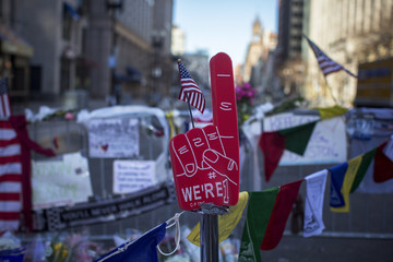 A foam placard in the shape of a hand gesturing number one stands by a makeshift memorial for the victims of the Boston Marathon bombings on Boylston street in Boston