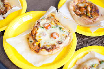 pizza with vegetables, meat and cheese