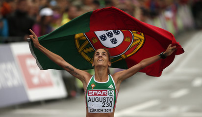 Jessica Augusto of Portugal reacts as she crosses the finish line to finish third in the the women's marathon during the European Athletics Championships in Zurich