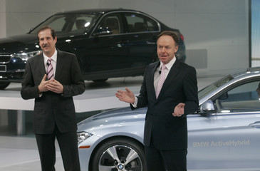 BMW's Draeger and Robertson speak at the unveiling of the new BMW 3-series during the first press preview day for the North American International Auto Show in Detroit