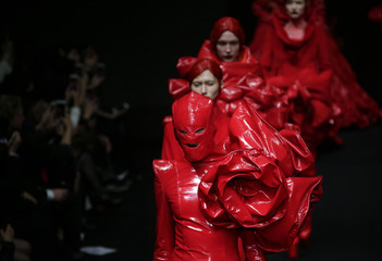 Models present creations by Chinese designer Hu Sheguang at China Fashion Week in Beijing