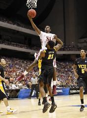 Seminoles' Singleton goes to the basket over Rams Skeen during their NCAA Southwest Regional college basketball game in San Antonio