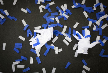 White gloves and confetti are seen on the ground after the NYPD graduation ceremony in New York