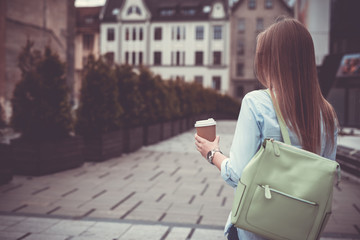 Beautiful girl in the city drinking coffee