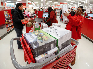 Store employee helps a customer with his purchase during the Black Friday sales event on Thanksgiving Day at Target in Chicago
