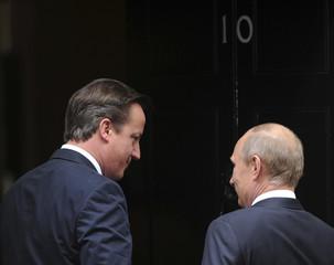 British Prime Minister David Cameron escorts Russian President Vladimir Putin at 10 Downing Street in London