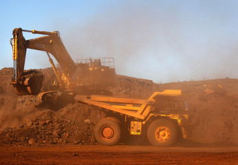Trackhoe fills a dump truck in the South Limb pit at Atlas Iron's Pardoo mine, near Port Hedland