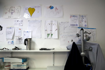 Children's drawings are posted on the wall of the dentist's office at the Doctors of the World polyclinic in central Athens