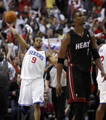 76ers forward Iguodala throws the ball behind Heat forward Bosh after the 76ers defeated the Heat in Game 4 of their NBA Eastern Conference playoff series in Philadelphia