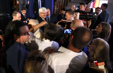 U.S. Republican presidential candidate and former Speaker of the House Gingrich greets supporters after speaking at a Hispanic Town Hall Meeting in Elgin
