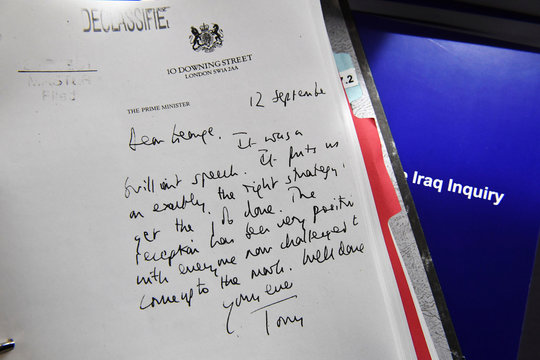 Detail of a declassified handwritten letter sent by the then British PM Tony Blair, to George Bush, is seen as part of the Iraq Inquiry Report, in London