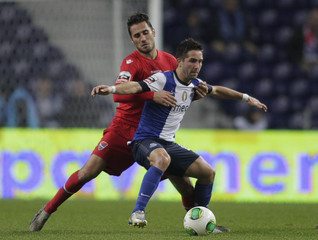 Porto's Moutinho battles for the ball with Gil Vicente's Mendes during their Portuguese Premier League soccer match at the Dragao stadium in Porto