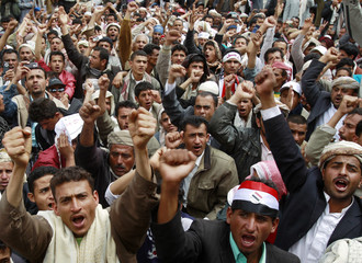Anti-government protesters shout slogans during a rally demanding the ouster of Yemen's President Ali Abdullah Saleh in Sanaa