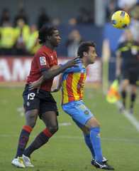 Osasuna's Balde and Levante's Lopez fight for the ball during their Spanish First Division soccer match in Pamplona