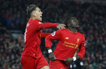 Liverpool's Sadio Mane celebrates scoring their first goal with Roberto Firmino