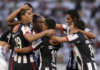 Morales of Mexico's Monterrey celebrates a goal with teammates against Colombia's Once Caldas during their Copa Libertadores soccer match in Manizales