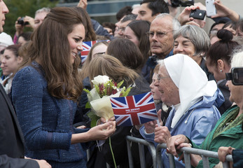 Catherine, the Duchess of Cambridge, speaks to a nun during a walkabout in Civic Square, Wellington