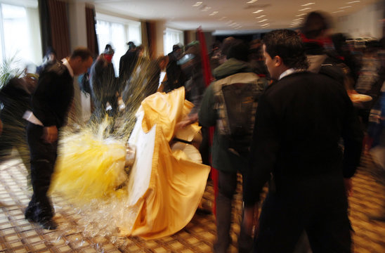 Student protesters overturn tables of croissants and orange juice prior to National Bank Financial Group annual general meeting in Montreal
