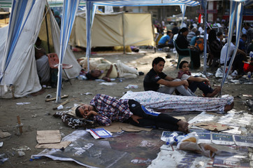 Protesters opposing Egyptian President Mursi sleep during a sit-in protest at Tahrir Square in Cairo