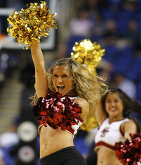 A Boston College Eagles cheerleader performs on the court during the second half of their ACC Championship college basketball game in Greensboro