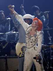 Lady Gaga finishes performing a medley of songs as a tribute to the late David Bowie with Bowie collaborator guitarist Rogers at the 58th Grammy Awards in Los Angeles
