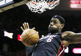Heat's James dunks against the Spurs during Game 4 of their NBA Finals basketball series in San Antonio