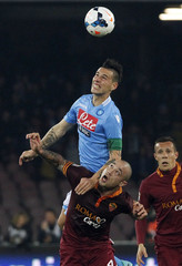 Napoli's Hamsik challenges Nainggolan of AS Roma during their Serie A soccer match at San Paolo stadium in Naples