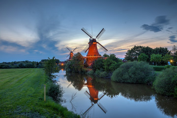 Poster Molens Two windmills in Greetsiel at the blue hour