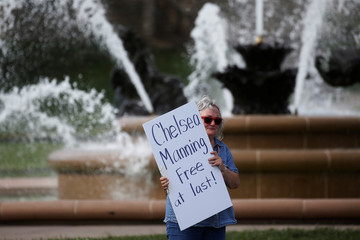 A woman takes part in a small rally in support of Chelsea Manning in Kansas City