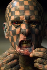 """Matt Gone, also known as """"The Checkered Man"""" poses during the last day of the Quito Tattoo Convention"""