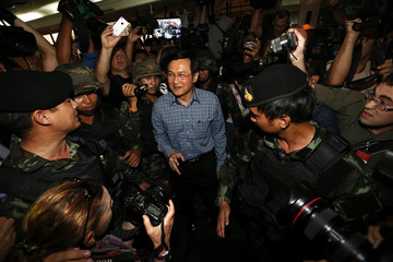 Former Thai Education Minister Chaturon is surrounded by soldiers as he is being detained in Bangkok