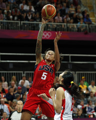 Augustus of the U.S. shoots over China's Miao during their women's preliminary round Group A basketball match at the Basketball Arena during the London 2012 Olympic Games