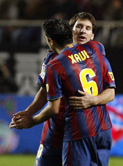 Barcelona's Messi and Xavi celebrate their first goal against Sevilla during their Spanish King's Cup soccer match in Seville