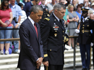 Obama and Linnington bow their heads Memorial Day observances at Arlington National Cemetery in Arlington
