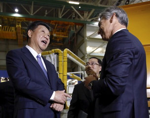 Chinese President Xi Jinping and Ray Conner, president and CEO of Boeing Commercial Airplanes, tour the Boeing assembly line in Everett, Washington
