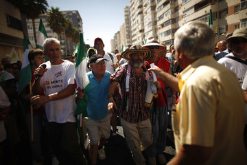 A man confronts Marinaleda's Mayor Gordillo during a protest against austerity measures in Cadiz