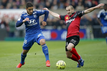 Guingamp's Mathis is challenged by Olympique Lyon's Fekir during their French Ligue 1 soccer match at the Roudourou stadium in Guingamp