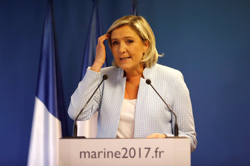 Marine Le Pen, French National Front (FN) political party leader, delivers a statement on US election results at the party headquarters in Nanterre