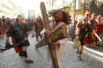 "Actors take part in a re-enactment of the ""Via Crucis"", which commemorates the crucifixion of Jesus Christ, during the Orthodox Church's Good Friday celebrations in Bucharest"