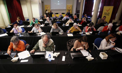 Volunteers inform citizens about the polling places for the 9N consultation from a call center in Barcelona