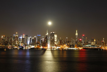 File photo of a full moon rising over the New York skyline above 42nd Street, seen from across the Hudson River in Weehawken, New Jersey