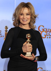 Jessica Lange poses with her award for best performance by an actress in a supporting role in a series, mini-series or motion picture made for television in Beverly Hills